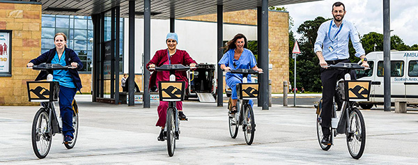 health workers on bicycles